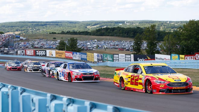 Joey Logano (22) leads a pack of cars during the 2016 Monster Energy NASCAR Cup Series race at Watkins Glen International.