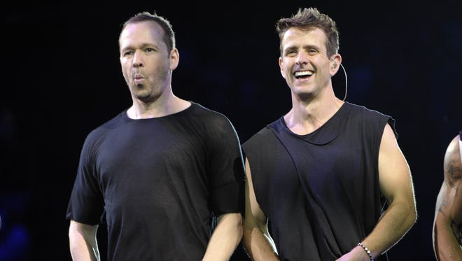Donnie Wahlberg (left) and Joey McIntyre (right) of New Kids on the Block perform Friday at the Palace.