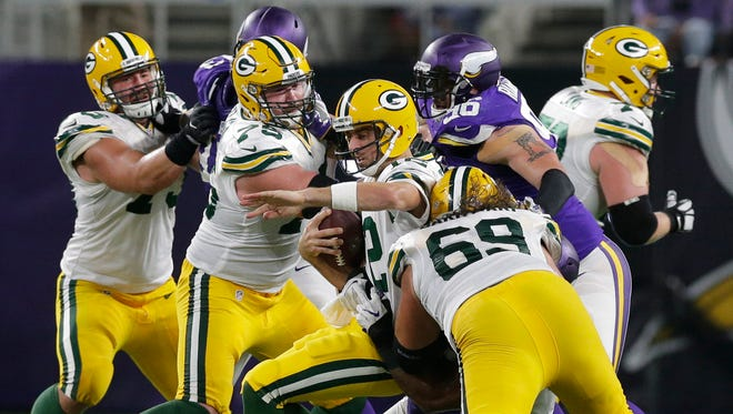 Green Bay Packers quarterback Aaron Rodgers  is sacked.