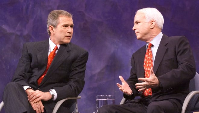 U.S. President George W. Bush and Sen. John McCain at the Iowa debate on Jan. 15, 2000. After the 2000 election, the Senate was split 50-50. McCain's goal was to build bipartisan support for his crusades and he transitioned easily into his new role as the No. 1 Republican counterweight to Bush.