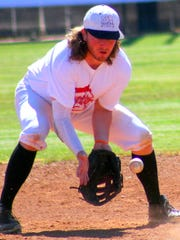 Cameron Haskins, a former New Mexico State Aggie, catches a ground ball during practice.