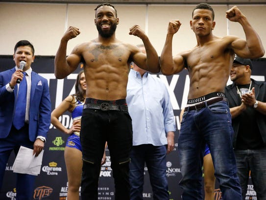 Austin Trout and Juan de Angel pose off at center stage