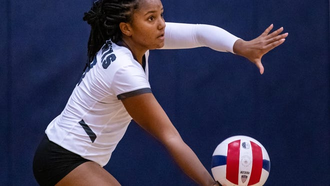Hendrickson senior Skylar Cavil, serving against Connally last fall, hopes to play college volleyball. She has received guidance from her father, Kwame Cavil, a former University of Texas football player.