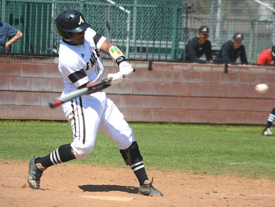 Abilene High catcher Terrell Franklin ropes a single