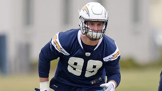 San Diego Chargers defensive end Joey Bosa (99) participates in a drill during rookie mini camp at Charger Park.