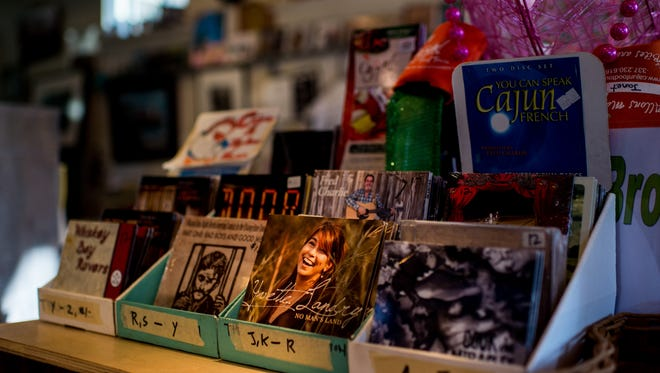 Several local music titles are on display for sale at Johnson's Boucaniere in downtown Lafayette.