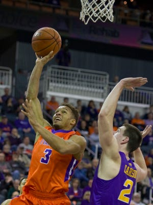 Evansville's Jaylon Brown (3) shoots over Northern Iowa's Klint Carlson during their game at The Ford Center Sunday afternoon.