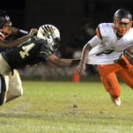 Cocoa's Timmy Pratt tries to get past Brandon Mays of Viera during Friday's game in Viera.