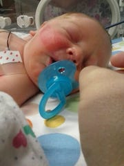Megan Price had her son, Robert, in front of OhioHealth Mansfield Hospital around 9 a.m. Saturday.