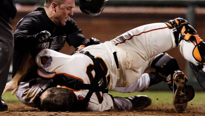 Giants catcher Buster Posey missed most of the 2011 season after a collision at home plate.