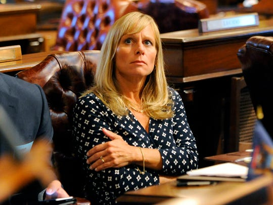 State Rep. Cindy Gamrat  watches the votes roll in to expel Gamrat and fellow Rep. Todd Courser in the House of Representatives Thursday, Sept. 10, 2015.