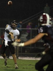 Hendersonville QB  Brett Coker throws against Station