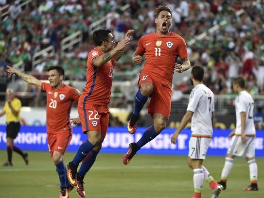 Chile's Eduardo Vargas (C) celebrates after scoring