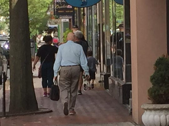Pedestrians walk along Haddon  Avenue, or restaurant row, in Collingswood.