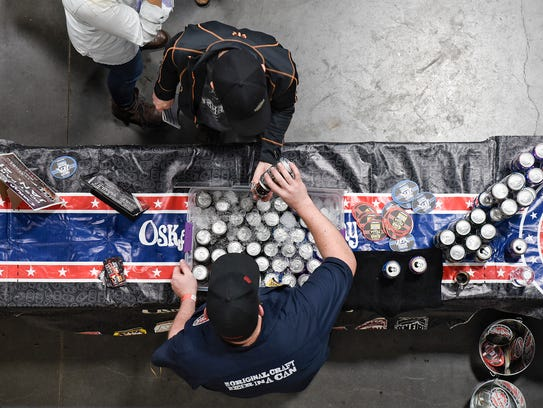Samples from Oskar Blues Brewery are served Saturday,