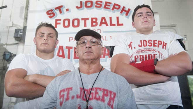 St. Joseph seniors Mike Mascioli, left, and J.D. DiRenzo, right, hope to give coach Paul Sacco, center, his 300th win and an eighth consecutive state title this season.