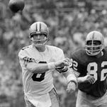 Former Saints quarterback Archie Manning throws a pass during a 1971 NFL game against the Washington Redskins.