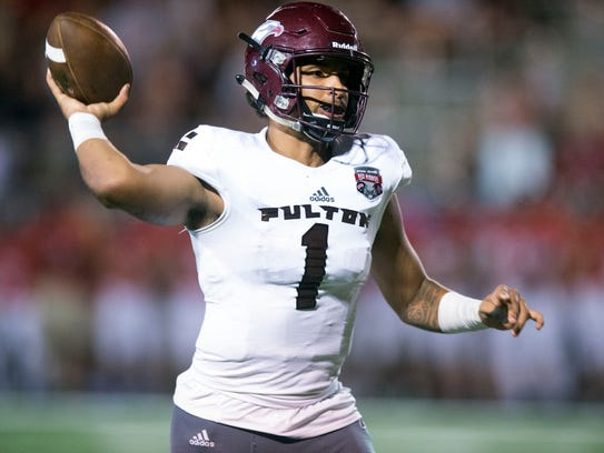Fulton's Xavier Malone pulls back to throw during the