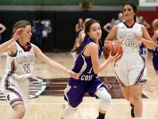 Sevier County's Amanda Clabo is defended by Morristown