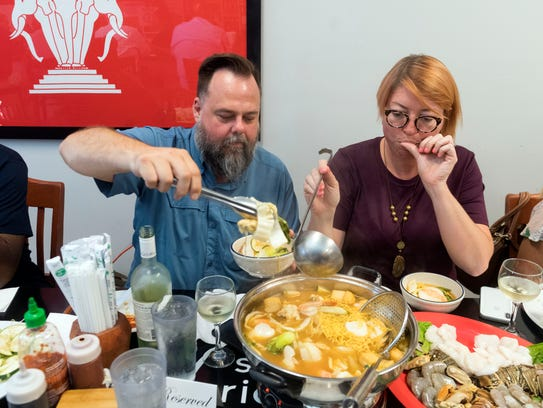 Eric and Mandee McNew of KnoxFoodie gathered a group of friends for a hot pot dinner at Sticky Rice Cafe on Tuesday, June 5, 2018. Hot pot is a style of dining where foods are cooked in a soup at the table and self-served at the table.