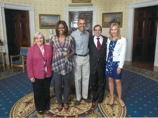 Paul Sauder and his wife Cindy (right), along with then-American Egg Board President and CEO Joanne Ivy, pose for a photo with President Barack Obama and First Lady Michelle Obama after presenting them with a ceremonial Easter egg at the 2014 White House Easter Egg Roll.