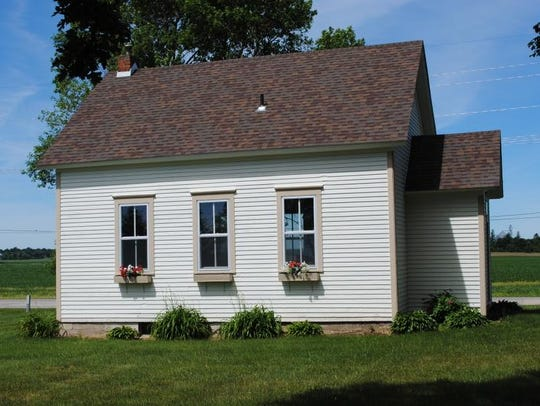 The Maple Grove one-room school was originally located