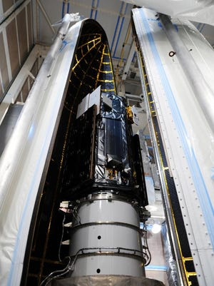 The half-ton OCO-2 spacecraft built by Orbital Sciences holds a single instrument that will use reflected sunlight to measure where carbon dioxide is being released and also absorbed.