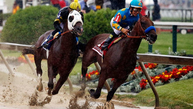 May 16, 2015; Baltimore, MD, USA; Victor Espinoza aboard American Pharoah leads Corey Nakatani aboard Mr. Z during the 140th Preakness Stakes at Pimlico Race Course. Mandatory Credit: Winslow Townson-USA TODAY Sports