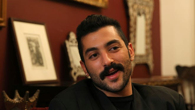"""In this April 27, 2016 photo, Hamed Sinno, lead singer and song writer of the Lebanese group Mashrou' Leila (""""Leila's Project"""") band, speaks during an interview in Beirut. Egyptian authorities said on Sept. 25, 2017, they arrested seven people accused of being gay and promoting homosexuality for allegedly raising the rainbow flag of the LGBT movement at a concert."""