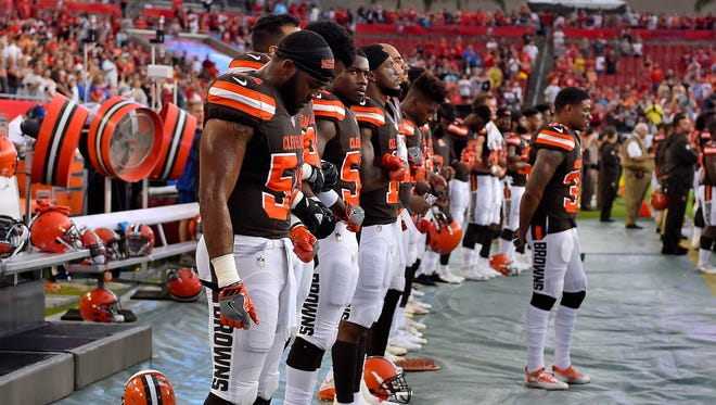 Browns teammates stand during the national anthem before the game against the Buccaneers.