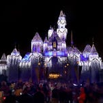 10 festively-lit theme parks for the holidays