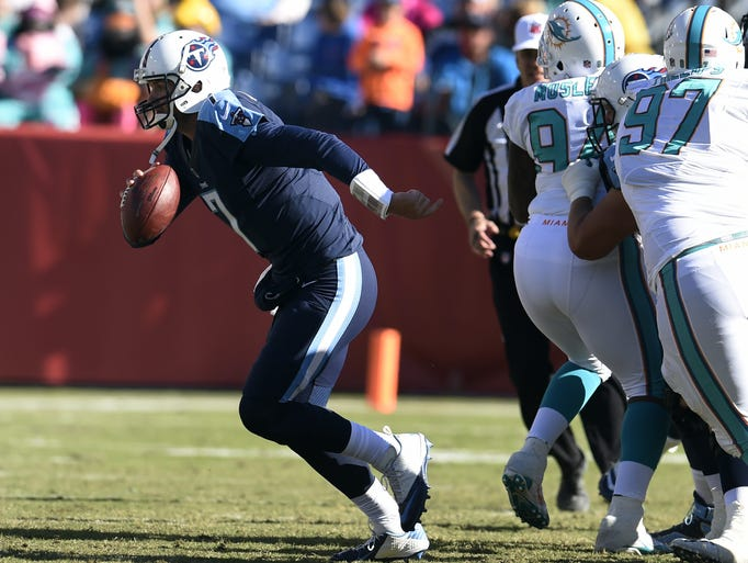 Titans quarterback Zach Mettenberger scrambles out