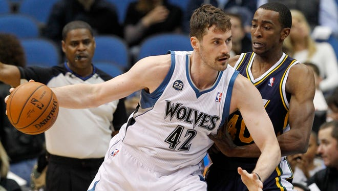 Minnesota's Kevin Love drives against Utah's Jeremy Evans in an April 16 game. Sources say Love will be traded to the Cavaliers for Andrew Wiggins, Anthony Bennett and a first-round pick.