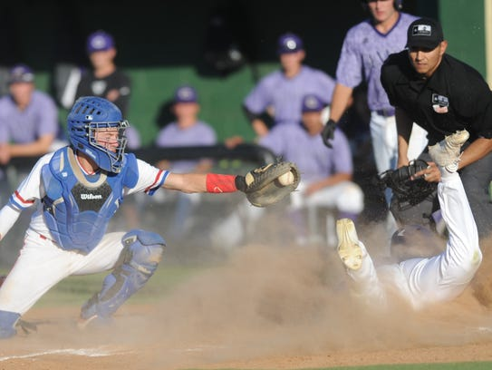 Cooper catcher Jacob Hummel, left stretches to tag Canyon's Gunnar Palacios at home plate. Palacios scored on Cash Hamby's ground out in the seventh inning. Canyon won the Class 5A bi-district playoff game 14-3 Friday, May 5, 2017 at Lubbock High's Westerner Field to take a 1-0 lead in the best-of-three series.