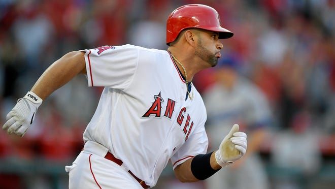 Los Angeles Angels' Albert Pujols rounds first as he hits a solo home run during the sixth inning of a baseball game against the Los Angeles Dodgers, Sunday, July 8, 2018, in Anaheim, Calif. (AP Photo/Mark J. Terrill)