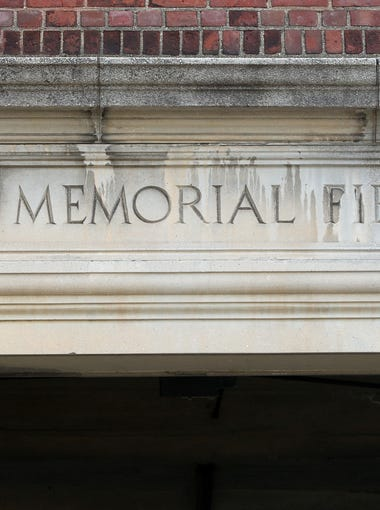 An engraved stone sign over one of the entrances to