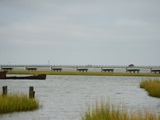 Vehicles cross a section of the Chincoteague causeway that connects to the island's drawbridge.