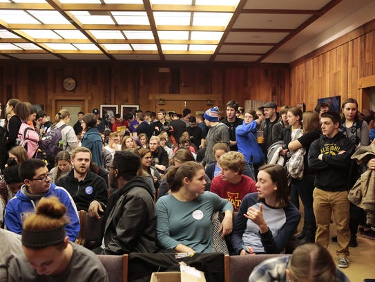 Students flood the room as they wait to vote on which