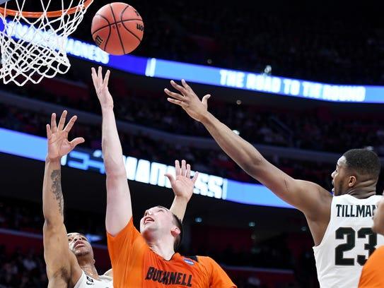 Bucknell's Zach Thomas, center, shoots between Miles