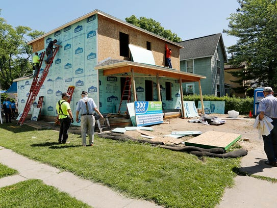 Guests take in the work in progress as they arrive at a Habitat for Humanity home in Lafayette, Indiana.