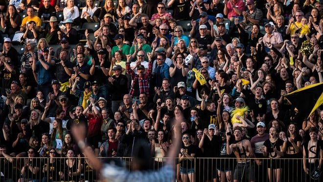 Harwood fans cheers a goal during the boys lacrosse championship game at Virtue Field at UVM on Friday night, June 8, 2018.