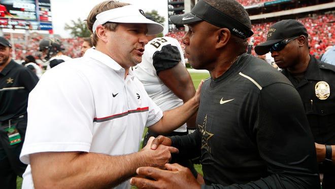 Georgia head coach Kirby Smart, left, and Vanderbilt head coach Derek Mason meet at midfield after in an NCAA college football game Saturday, Oct. 15, 2016, in Athens, Ga. Vanderbilt won 17-16. (AP Photo/John Bazemore)