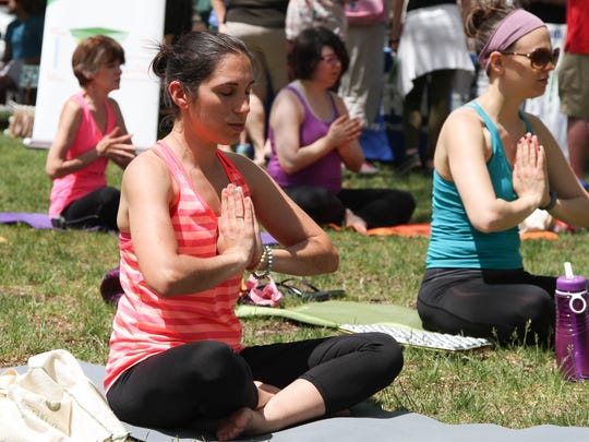 Rose Guida takes a yoga class at the start of Festival Earth, a sustainability fair at the Vail Mansion in Morristown on May 17, 2015. Festival Earth included a Sustainable Living Expo, performance stage, arts showcase, farmers market, hybrid-electric auto show, healthy foods pavilion and more.