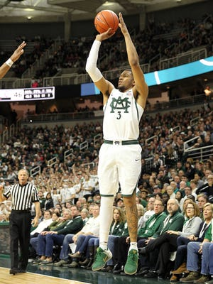 Michigan State guard Alvin Ellis III (3) attempts a three-point basket during the second half of MSU's 74-66 win Tuesday at Breslin Center.