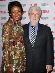 Chicago investment honcho Mellody Hobson, pictured here with her husband, director George Lucas, was an early donor to a political action committee founded by black business executives.