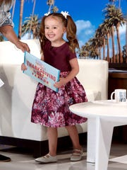 "In this photo released by Warner Bros., Brielle Milla smile during a taping of ""The Ellen DeGeneres Show"" at the Warner Bros. lot in Burbank, Calif."