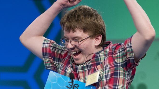 """Eighth grade home-schooled pupil Jacob Williamson, 15, of Cape Coral, Fla., reacts after correctly spelling his word """"harlequinade"""", during the semifinals of the Scripps National Spelling Bee, Thursday, May 29, 2014, at National Harbor in Oxon Hill, Md.   (AP Photo/Manuel Balce Ceneta)"""