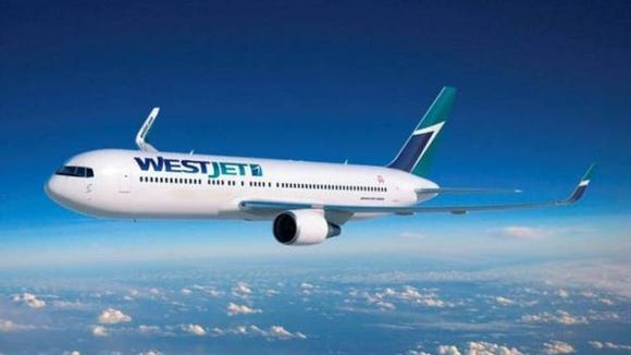 8457867d4974 This image shows a Boeing 767-300ER in WestJet s colors.
