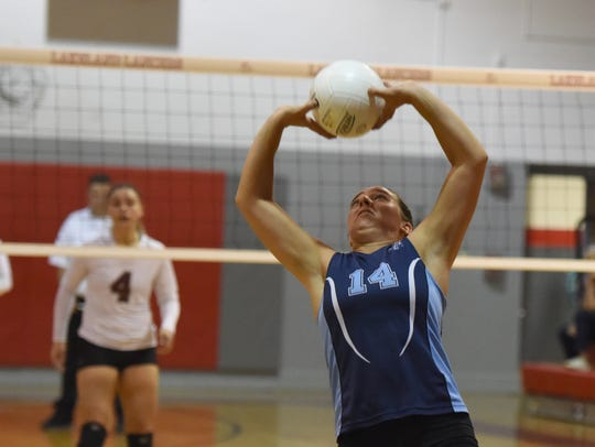 Wayne Valley senior Lauren DeVoe (14) sets a ball for a teammate in Wednesday's Passaic County tournament semifinals versus Clifton in Wanaque.