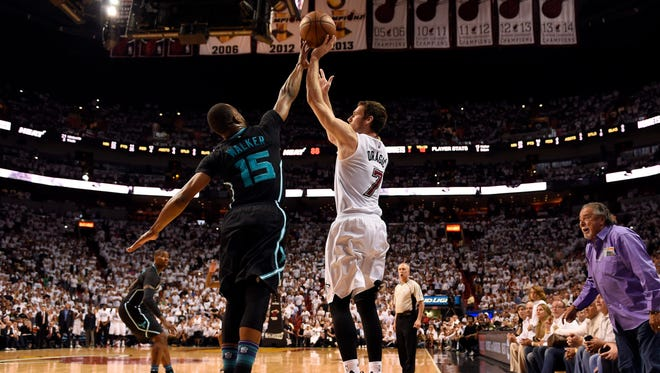 Miami Heat guard Goran Dragic (7) shoots over Charlotte Hornets guard Kemba Walker (15) during the second half.